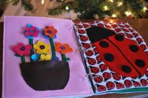 Page 3: Button flowers (with extra in the pocket). Page 4: A zipper lady bug whose spots are attached with snaps.