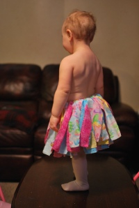 Helping Mommy model her cousin's tutu.