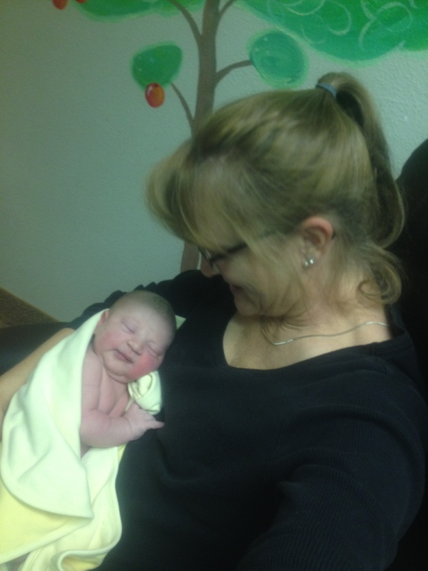 My mama's first time to hold Elsie, while we were waiting to be discharged.