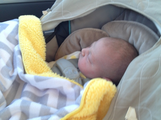 So tiny looking in her car seat!