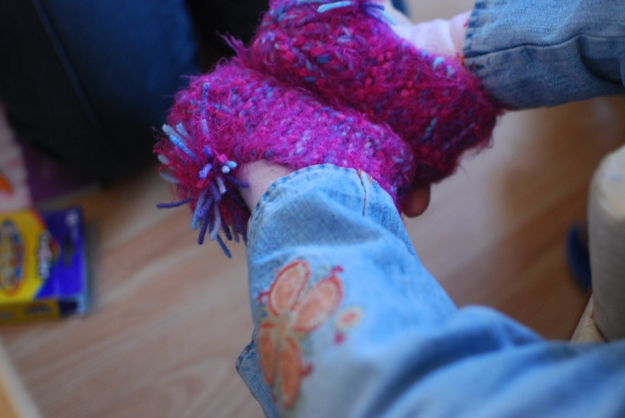 Beautiful slippers my cousin crocheted for Ladybug on her cute little feet!